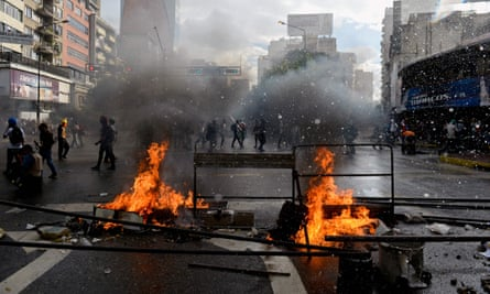 Opposition activists in Venezuela protest against the newly inaugurated constituent assembly.