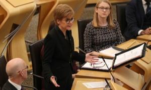 Nicola Sturgeon (centre) in the debating chamber during FMQs at the Scottish parliament in Edinburgh.