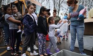 School employee distributing food to children