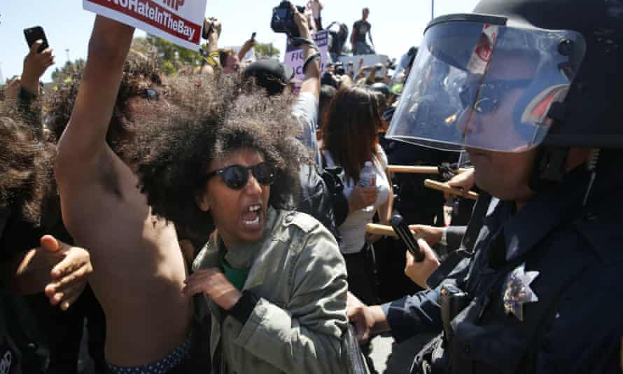 Oakland protester Biseat Yawkal is pushed by police during a demonstration outside of the California Republican party convention in Burlingame last month.