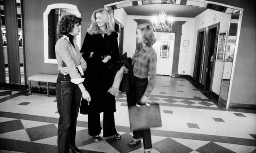 Three models chatting in the hotel lobby in 1977.