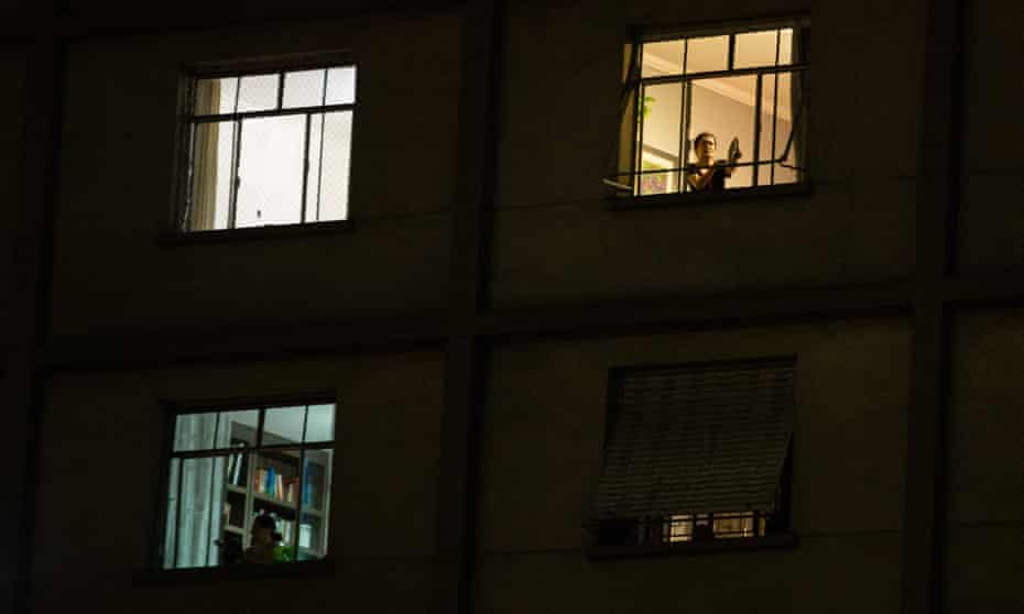 Protesters stand on their windows making noise with pots and pans (Panelaco) against President of Brazil Jair Bolsonaro