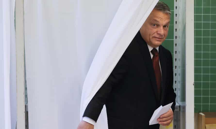 Hungarian prime minister Viktor Orbán exits a voting cabin after casting his ballot in the referendum in Budapest.