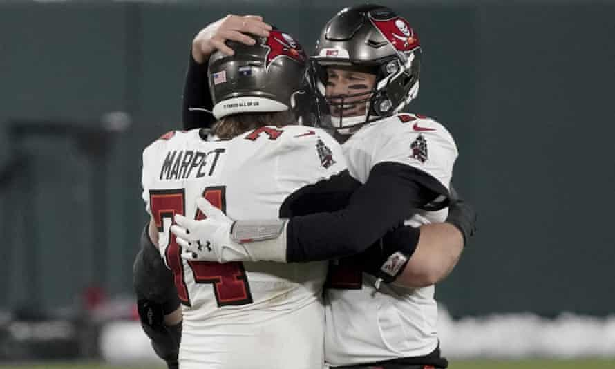 Tom Brady celebrates with Ali Marpet after winning the NFC championship