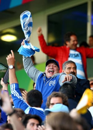 Those scarey masked fans were joined in cheering on Argentina by Diego Maradona