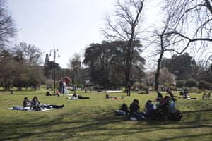 People relax at Sempione park, in Milan