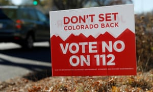 A sign in Denver last year urges voters to reject Proposition 112.