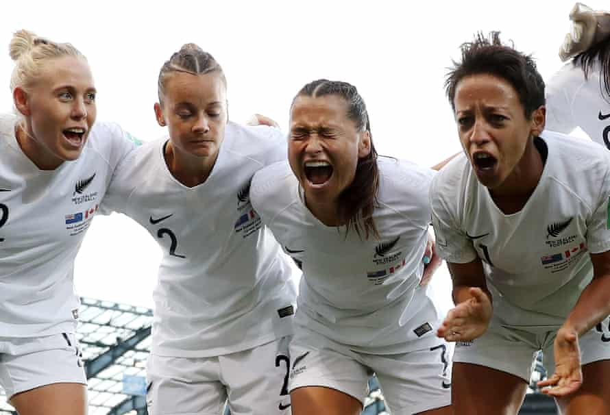 Ali Riley of New Zealand encourages her team before kick off in a group E match between Canada and New Zealand at Stade des Alpes.