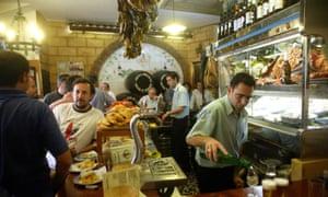 Busy interior of Bodega Santa Cruz tapas bar in Seville, Spain