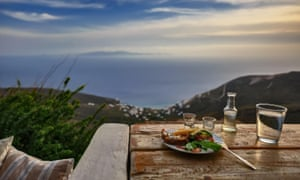 A tsipouro drink with meze and great view to the Aegean in Tinos.