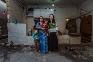A Syrian family lives in a half-built house in Salinufra, Turkey. Originally from Kobane, the family have been living in the partly exposed house for the past 20 months, paying nearly $200 in monthly rent.