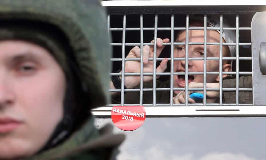 A protester shouts from a police bus after being detained during March's anti-corruption rally in central Moscow.