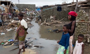 Residents survey the devastation caused by Cyclone Idai in the Mozambican city of Beira