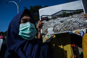 Activists campaign against imported plastic waste near the US consulate general office in Surabaya, in Indonesia's East Java province