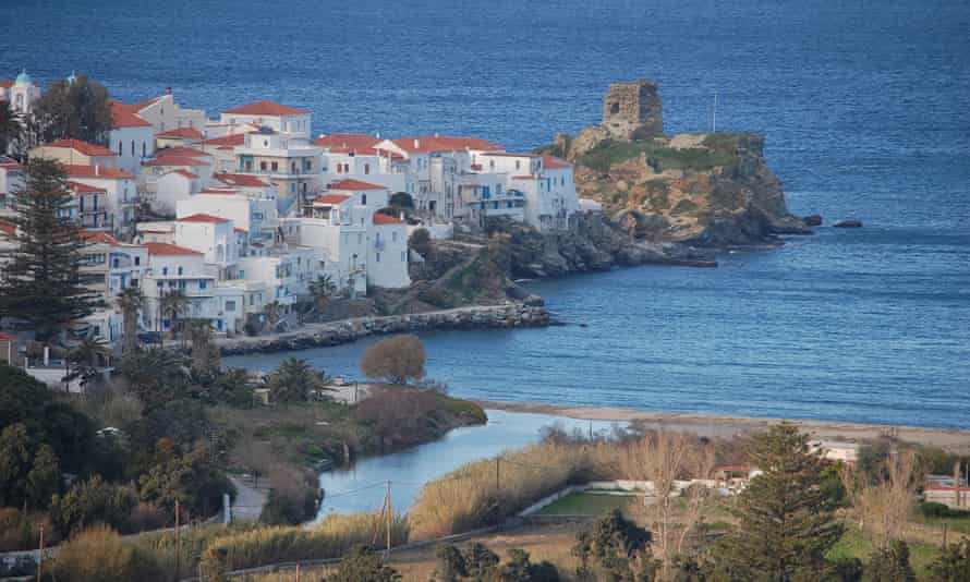 The town of Chora, Andros, jutting out into the sea.