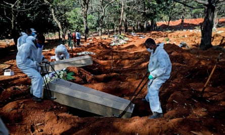 Gravediggers work in the Vila Formosa cemetery, in São Paulo, Brazil, on Monday, where they buried 62 bodies in 12 hours.