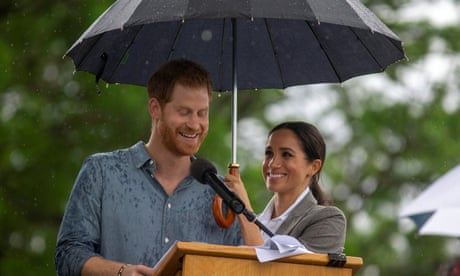 Long may they rain ... Prince Harry and Meghan upstaged by Dubbo downpour