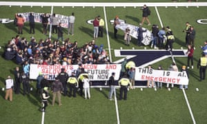 Demonstrators stage a climate change protest at the Yale Bowl in New Haven, Connecticut.