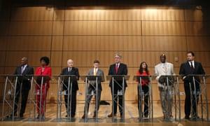 Maryland Democratic gubernatorial candidates (from left) Rushern Baker, Valerie Ervin, Jim Shea, Alec Ross, Richard Madaleno, Krish Vignarajah, James Jones and Ben Jealous, prepare for a debate.