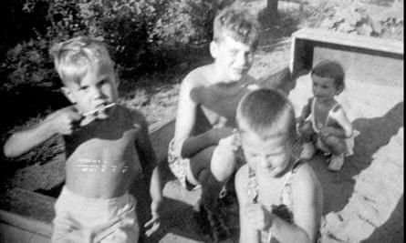 David Kaczynski, left, and his older brother Theodore John Kaczynski, center, in a sandbox with neighbors.