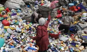 People sort through waste at a collection centre in Nairobi