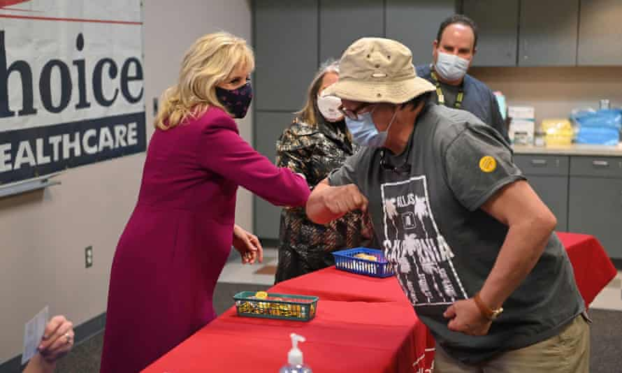The US first lady, Jill Biden, elbow bumps a man