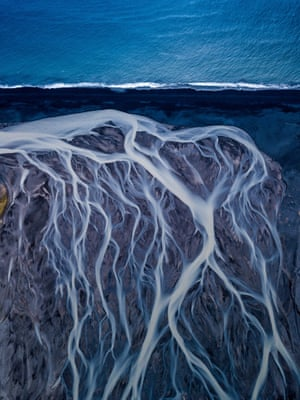 A glacial river flowing down to the Atlantic Ocean, Southern Iceland: gold prize in nature art category
