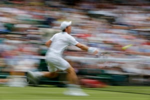 Andy Murray charges the net during his 6-2, 4-6, 6-1, 7-5 victory over Fabio Fognini on Centre Court