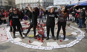 Magic circle: protesters chant against gender-based violence at their camp on La Puerta del Sol square in Madrid, Spain.