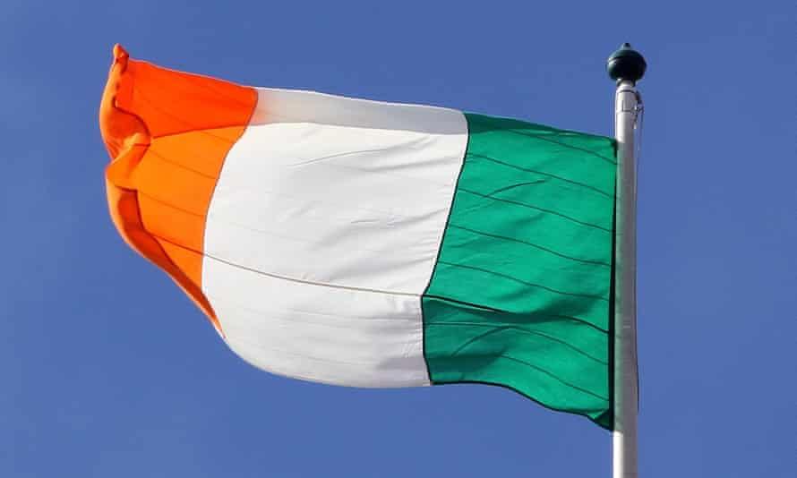 The Irish flag against a blue sky