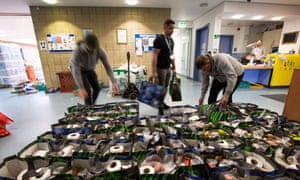 Volunteers in Glasgow organise food parcels to be delivered to vulnerable families