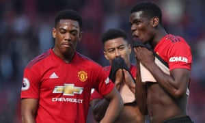 Paul Pogba (right) was subject of abuse by a Manchester United fan after the match.