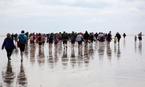 Walkers on the Arnside to Kents Bank guided tour.