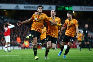 Raul Jimenez of Wolverhampton Wanderers celebrates with teammates Diogo Jota and Ruben Vinagre after scoring his team's equaliser.