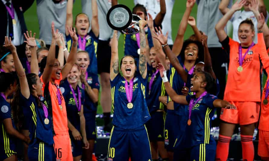 Lyon's Dzsenifer Marozsan holds aloft the Women's Champions League trophy after her team's final win against Wolfsburg in August last year.