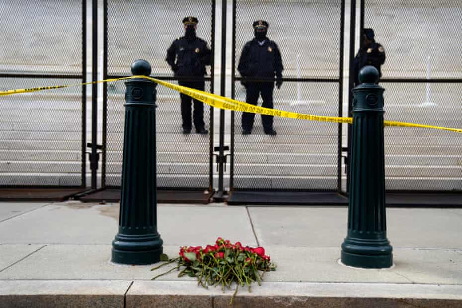 Flowers left outside the US supreme court by anti-abortion campaigners in Washington DC during the 'March for Life' on 29 January.