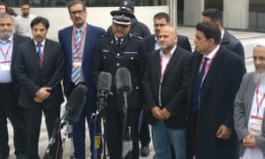 Mak Chishty, centre, with leaders of London's Muslim community outside Scotland Yard