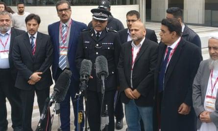 Mak Chishty, centre, with leaders of London's Muslim community outside Scotland Yard