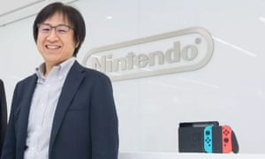 Nintendo's Shinya Takahashi with the Switch console.