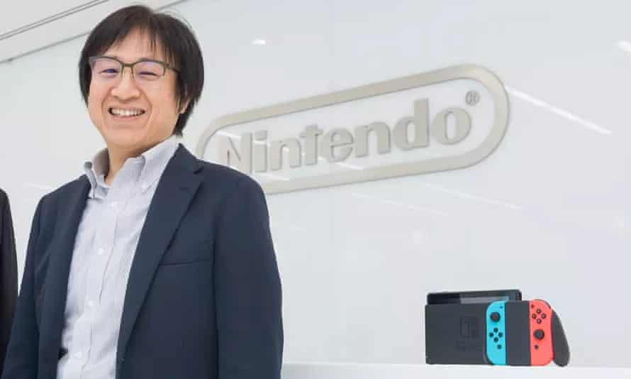 Nintendo's Shinya Takahashi with the Switch console.