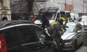 Police from the Tactical Aid Unit prepare to enter a block of flats in Manchester on Wednesday, one of a series of raids following the attack.