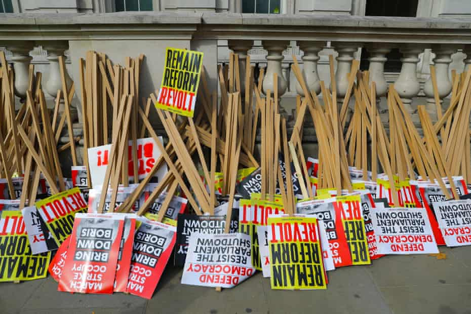 Placards outside Downing Street before a protest on Saturday.