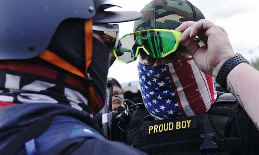 A member of the Proud Boys stands confronts a counterprotester at a rally in Portland.