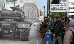 Checkpoint Charlie in Berlin in 1961 and the same area in 2019. Fewer than 25% of Germans over 40 think the world is safer now than in 1989, according to a new survey.