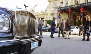 A luxury car in front of the Monte Carlo casino in Monaco.