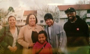 Rollie Pemberton rocking a full Rocawear tracksuit in the late 1990s with his family in Edmonton
