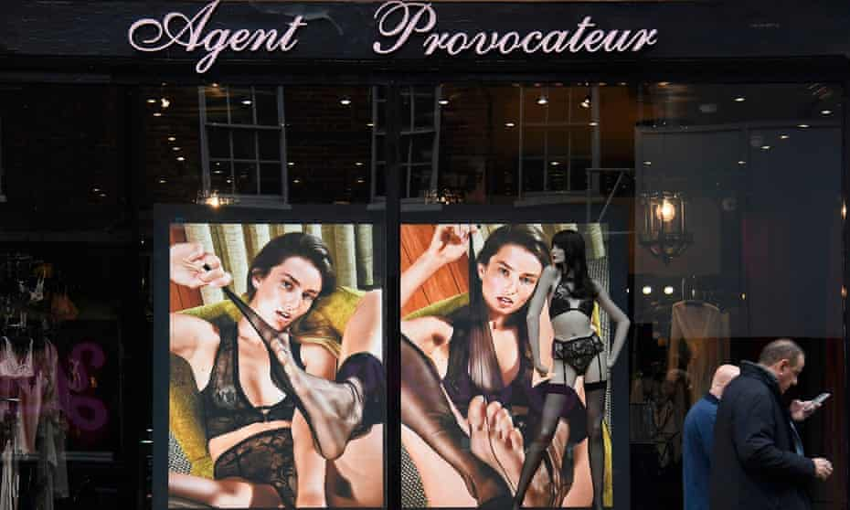 Men walk past a branch of Agent Provocateur in London.