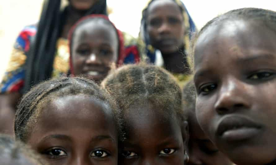 Children of Nigerian refugees stand at a Chadian camp after fleeing Boko Haram.