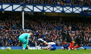 Dominic Calvert-Lewin nutmegs Kepa to make it 3-1 during the Premier League match between Everton and Chelsea at Goodison Park.