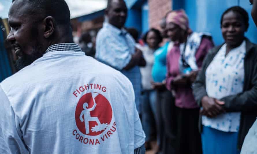 A member of a local NGO installs handwashing stations at the Kibera slum in Nairobi, Kenya's capital, on 18 March.